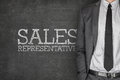 Sales representative on blackboard with businessman side Royalty Free Stock Photo