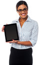 Sales representative displaying tablet pc for sale posing with newly launched device Royalty Free Stock Photo