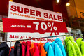 Sales in a textile shop total due to stock clearance sale Royalty Free Stock Photos
