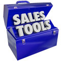 Sales tools words toolbox selling technique scheme the in a green metal to illustrate techniques methods schemes plans or Royalty Free Stock Images