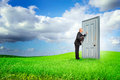 Salesman businessman or with briefcase knocking at a door outdoors Royalty Free Stock Photography