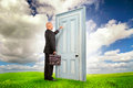 Salesman businessman or with briefcase knocking at a door outdoors Stock Images