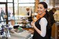 Salesperson at cash register saleswoman working in shop Royalty Free Stock Photo