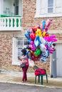 The saleswoman of balloons on Nestenarskih games in the village Bulgarians
