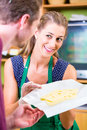 Saleswoman at counter offering cheese organic supermarket customer Stock Image