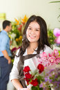Saleswoman and customer in flower shop Royalty Free Stock Photo