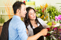 Saleswoman and customer in flower shop friendly asian florist or a advising a Royalty Free Stock Images