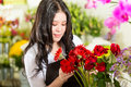 Saleswoman in a flower shop Stock Photo