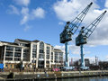 Salford quays manchester dock cranes at ontario basin the england uk Stock Photography