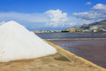 Salina salt hills under blue sky sicily italy Royalty Free Stock Photo
