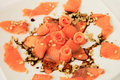 Salmon carpaccio with cedar nuts Stock Photos