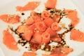 Salmon carpaccio with cedar nuts Stock Photos