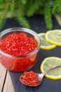 Salmon caviar. Red caviar and lemon. New year Royalty Free Stock Photo