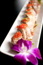 Salmon and caviar sushi rolls vertical Royalty Free Stock Photography