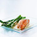 Salmon fillet with asparagus and sauce Royalty Free Stock Photo