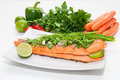 Salmon fillet diet food grilled fish salad with tomato bell pepper and carrot vegetables in background Stock Image