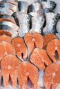 Salmon Fillet in Ice on the supermarket counter. Royalty Free Stock Photo