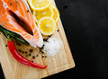 Salmon fillet with lemon on black Royalty Free Stock Photography