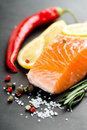 Salmon fillet with lemon on black Royalty Free Stock Image