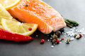 Salmon fillet with lemon on black Royalty Free Stock Images