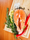 Salmon fillet with lemon rosemary and Royalty Free Stock Photos