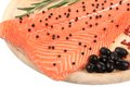 Salmon fillet on platter with olives. Royalty Free Stock Photo