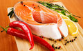 Salmon fillet with rosemary and lemon Royalty Free Stock Images