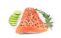 Salmon fillet with rosemary and lime isolated on a white background Stock Photography