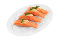 Salmon fillets clipping path with lemon slice and dill on ice in front of white background Royalty Free Stock Photo