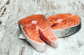 Salmon fillets surrounded by rustic background Stock Photography