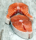 Salmon fillets surrounded by rustic background Royalty Free Stock Image