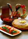 Salmon fish and caviar with pancakes. Royalty Free Stock Images