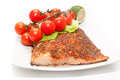 Salmon food grilled diet fish with tomato salad and lemon Stock Photography