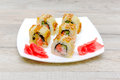 Salmon fried maki sushi hot roll with cream cheese and cucumbe cucumber inside horizontal photo Royalty Free Stock Images