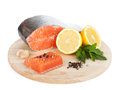Salmon with herbs and lemon slices on cutting board isolated on white background Stock Photography