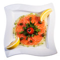 Salmon with lemon and cherry tomato slices of a on a square plate Royalty Free Stock Image