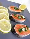 Salmon and lemon on plate Stock Photos
