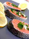 Salmon and lemon on plate Royalty Free Stock Images
