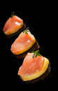 Salmon on lemon slices. Royalty Free Stock Photo