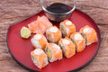Salmon maki roll with cream cheese and cucumber inside topped Royalty Free Stock Photography