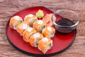 Salmon maki roll with cream cheese and cucumber inside topped Stock Photo
