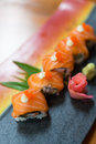 Salmon maki roll sliced on dish Stock Photography