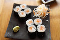 Salmon maki sushi on wood background Royalty Free Stock Photo