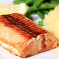 Salmon with mashed potatoes and vegetables Stock Image