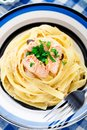 Salmon pasta delicious with mushrooms on a plate Stock Images