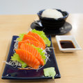 Salmon sashimi with garnish chopsticks soy sauce Stock Image