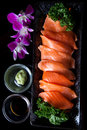 Salmon sashimi served with soy sauce and wasabi Stock Photo