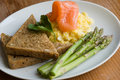 Salmon with scrambled egg and asparagus Royalty Free Stock Photography