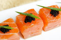 Salmon slices with black tobiko caviar and greens Stock Images
