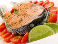 Salmon steak with cherry tomatoes and cream Royalty Free Stock Photo